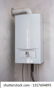 Modern home gas boiler, water heater. Water heating, ecology. Concept lifestyle.