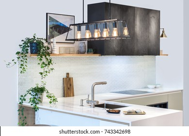 Modern home interior. Modern kitchen design in a light interior. Facades are painted and made of natural stone. European furniture, design, technologies. Copper Wire Pendant Light. Project management.