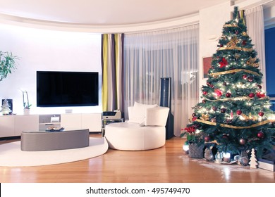 Modern home interior with large Christmas tree decoration