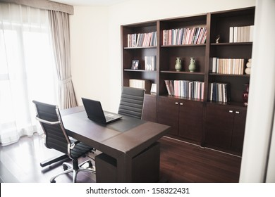 Modern home office with bookshelves