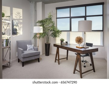 Modern home office room with wooden desk and chair