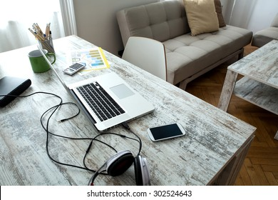 A modern home office setup on a wooden Table.