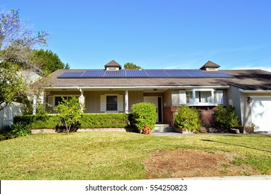Modern home with a solar panel on the roof in San Marino, CA.