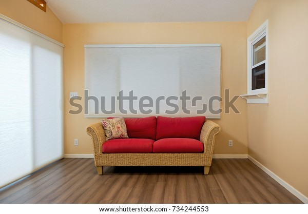 modern home sunroom interior decorated with rattan loveseat bamboo floors and blinds