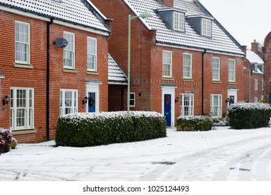 Modern homes in Bury St Edmunds, UK on a snowy day