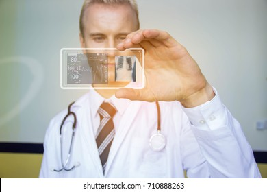 The modern hospital doctor uses a transparent hologram of the phone and looks at the patient's symptoms and treatment. Future health care concept