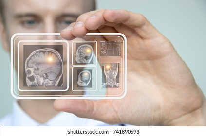 The modern hospital doctor uses a transparent hologram of the phone and looks at the patient's symptoms and treatment.Concept of care and preservation of health in the future,Smart medical concept.