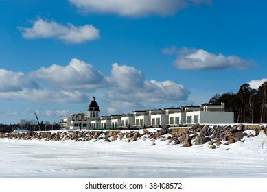Modern hotel on the Gulf of Finland bank in early spring in Saint-Petersburg countryside