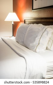 Modern Hotel Room Bed Pillows and Lamp