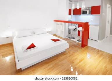 Modern hotel room or studio flat bedroom with kitchenette