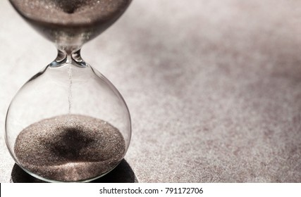 Modern hourglass with bright background for copy space. Hourglass time passing concept for business deadline, urgency and running out of time.