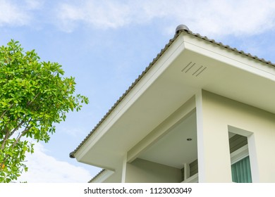 Modern house with balcony terrace, roof gutter system
