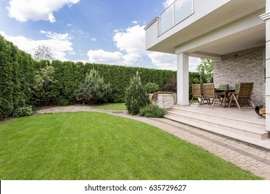 Modern house with beauty garden and terrace
