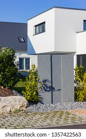 modern house building with green bushes at april spring month in south germany