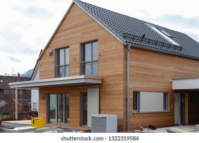 modern house and carports development area in south germany countryside village on february afternoon
