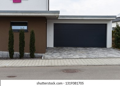 modern house carports in south germany countryside village on february afternoon