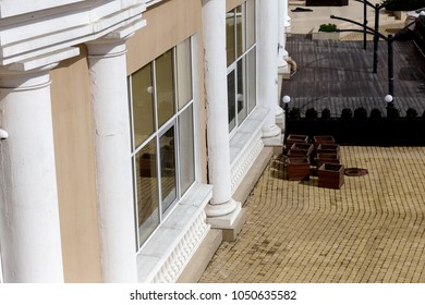Modern house with columns in seismically dangerous zone. House is collapsing from landslide. Cracks in wall of house, Colon and walls in dangerous cracks. Dangerous crack on facade of building