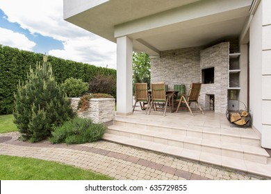 Modern house with cozy terrace and garden