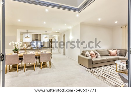 Modern House With A Door Entrance To The Living Room And Dining Kitchen Including Table Set