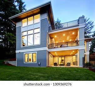 Modern house exterior lwith ush landscaping in the suburbs of North America