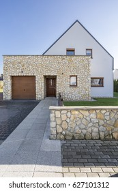 Modern house exterior with natural stone elevation