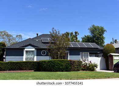 Modern house with a lawn, garden and solar panels on the roof. North Hollywood, CA.