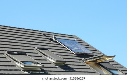 Modern House Roof with Solar Water Heater, Solar Panels and Skylights, Beautiful New Contemporary House with Solar Panels. Open attic skylights.
