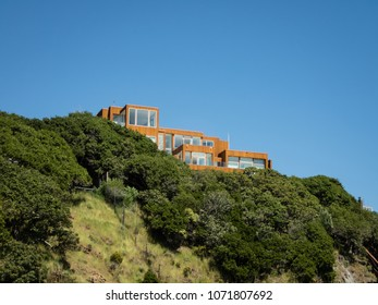 Modern house setting high on the edge of a cliff