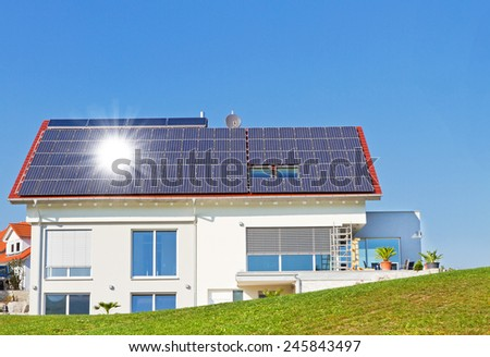 Modern house with solar cells in nature