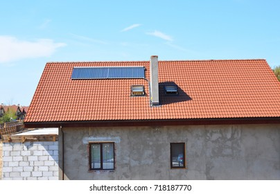Modern house with solar water heating system under construction