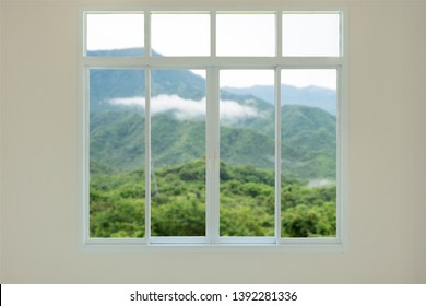 Modern house window view with mountain background