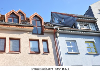 Modern House-Front with Dormer Windows of galvanized Steel