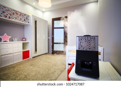 Modern humidifier in children room. System for maintaining fresh air in rooms.