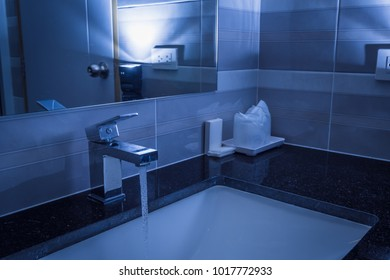 Modern hygiene wash basin with running clean water from the tap in bathroom