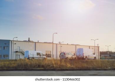 Modern industrial exterior building over blue sky