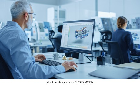 Modern Industrial Factory: Team of Mechanical Engineers Working on Computers, Using Newest High-Tech Devices Like Virtual Reality Headsets to Design Best Engines. 3D Graphics in Contemporary Industry - Shutterstock ID 1708950337