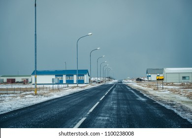 Modern industrial warehouse in Iceland . Winter scandinavian cityscape with empty streets.