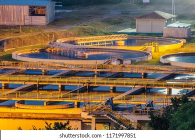Modern industrial wastewater treatment plant at night. Aerial view of sewage purification tanks.