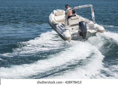 Modern Inflatable Rubber Speed Motor Boat on water
