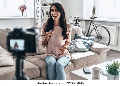 Modern influencer. Female vlogger making social media video while sitting indoors