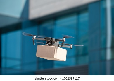 Modern innovative technology and gadget. Drone fast delivering medicines in cardboard box to sick people, contactless delivery