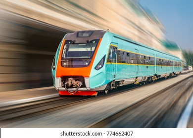 Modern intercity train at the railway station with motion blur.