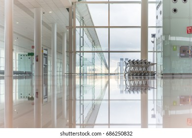 Modern Interior of an Airport Terminal Waiting Area. Empty Hall Interior with Large Windows