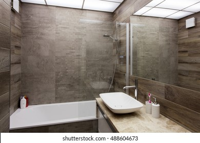 Modern interior of a bathroom in brown tones