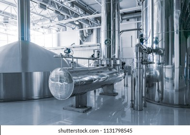 Modern interior of a brewery mash vats metal containers
