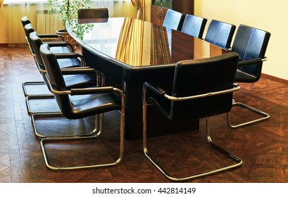 Modern interior of business  conference room with wooden table and chairs