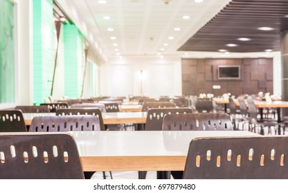Modern interior of cafeteria or canteen with chairs and tables, nobody