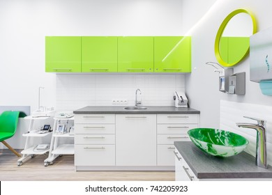 Modern interior of dentistry clinic with lime cabinets
