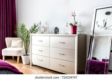 Modern interior design - bedroom details, tv stand and mirror decor
