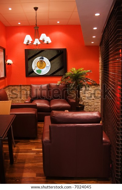 modern interior design corner, with leather furniture and iron lamps